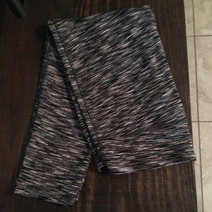 White, black, and gray striped leggings.